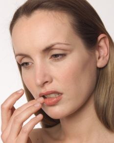 If I place my finger casually to my lips and look a little glum...